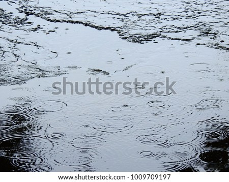 rain drop on water of flooded in the road #1009709197