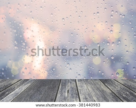Stock Photo Rain drop with defocused light with wood plank