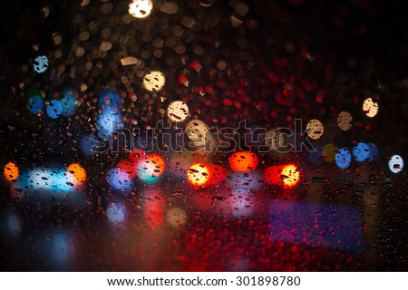 rain drop with street colorful traffic lights at night  blur bokeh abstract background vintage color tone, Cool chill wet raining season concept
