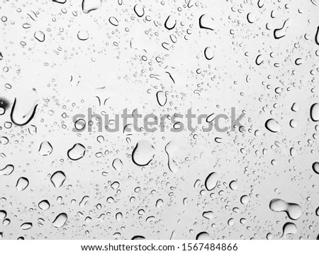 Rain droplet on glass surface
