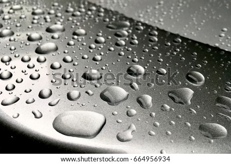 Rain dropped on glass coated of car. #664956934