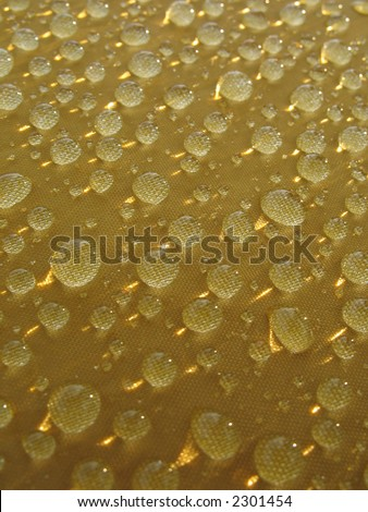 Rain drops at yellow surface. - stock photo