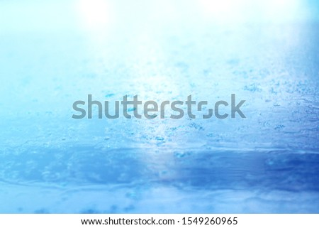 rain drops background and raining rain blue rain background.