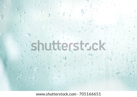 Rain drops background design abstract on window glasses surface with cloudy texture. Natural Pattern of water drop and sky wallpaper. #705166651