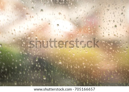 Rain drops background design abstract on window glasses surface with cloudy texture. Natural Pattern of water drop and sky wallpaper. #705166657