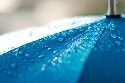 Rain drops on a blue umbrella , Raindrops on an umbrella , Rain drops shallow depth on blue , Raining Umbrella blue