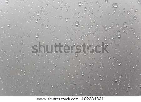 rain drops on black car roof/rain drops on car window #109381331