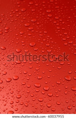 rain drops on orange car body, shallow focus