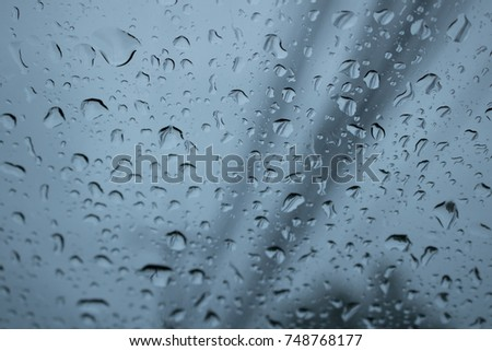 rain drops on the windshield #748768177