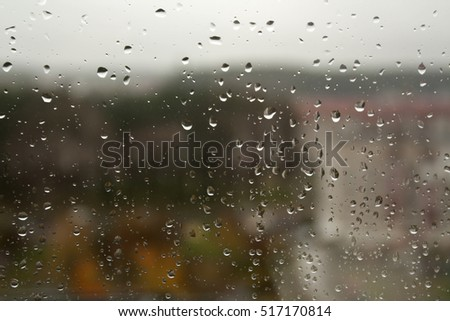 Rain drops on window closeup. Abstract background for design and ideas. #517170814