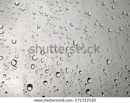 Rain drops on window glasses #671312560