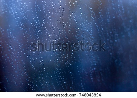 Rain drops window, bad weather. Abstract background.