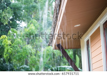 rain flows down from a roof down ストックフォト ©