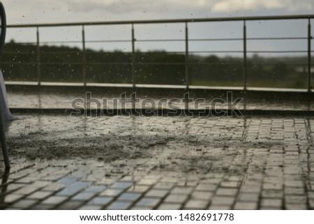 Rain. Heavy rain is dripping onto the tile. Heavy rain on a cloudy day.