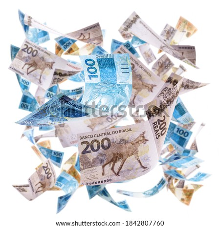 rain of money from brazil, notes and banknotes of two hundred, one hundred and fifty reais falling, with selective focus. Lottery, savings or prize concept Foto stock ©