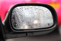 Rain on a car mirror