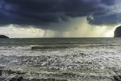 Rain on sea and dark storm clouds rain