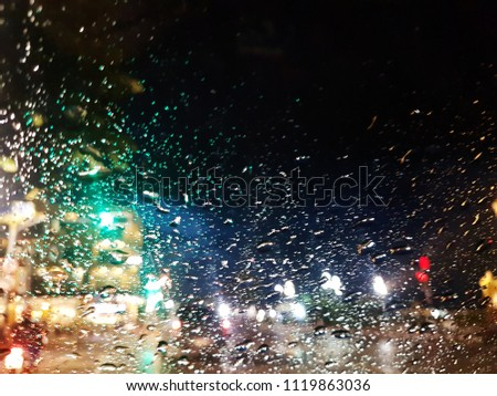 Rain On the glass Background bokeh . of colorful lights for use as illustrations in art and design #1119863036