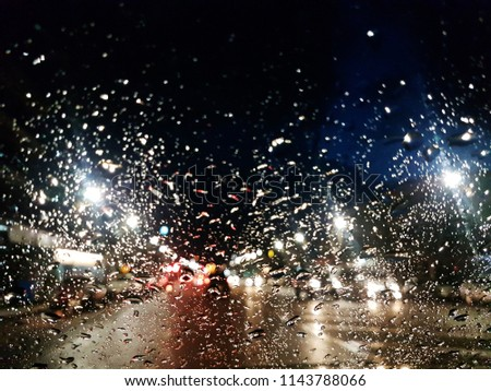 Rain On the glass Background bokeh . of colorful lights for use as illustrations in art and design #1143788066
