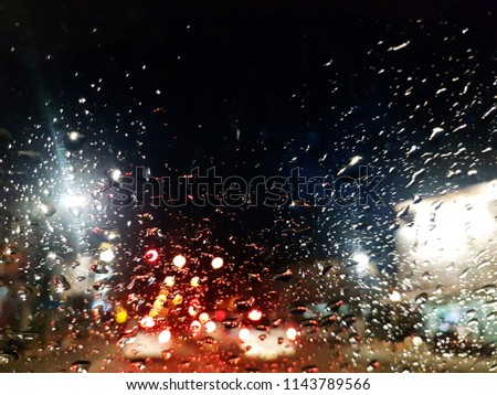 Rain On the glass Background bokeh . of colorful lights for use as illustrations in art and design #1143789566