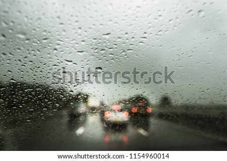 Rain on the motorway, heavy rain on the windshield, windscreen whilst driving on the motorway in a car, van, truck