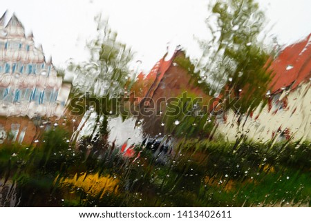 rain outside and snow the window. wet background. wet glass. out of focus