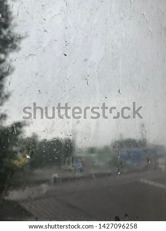 rain outside the window. glass in dirty stains from the rain. outside the window