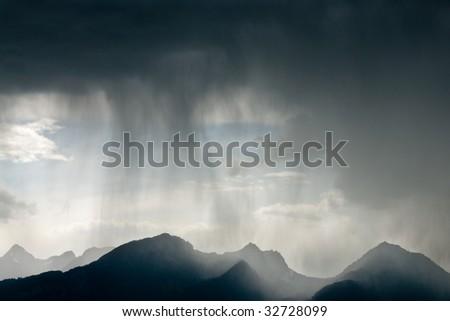 Rain over mountain peaks