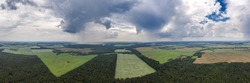 Rain over rural countryside aerial panorama. Rain clouds shot from a drone