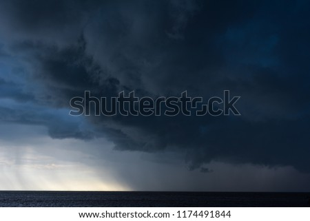 Rain strom cloudy darkness frightening sky in rainy season black dark color tone.