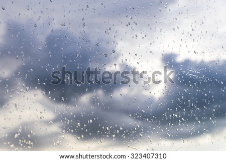 Rain / Water drop of rain on glass with outdoor background