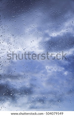 Rain / Water drop of rain on glass with outdoor background #504079549