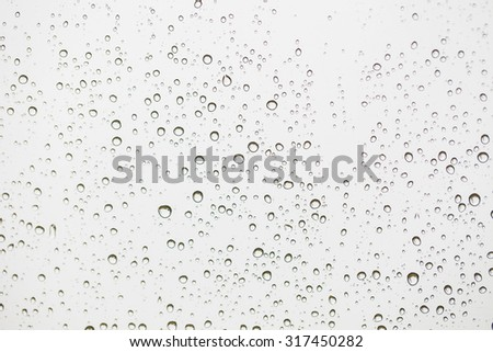 rain water drops on a glass  ...