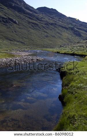 Rain water river in arctic tundra, Greenland