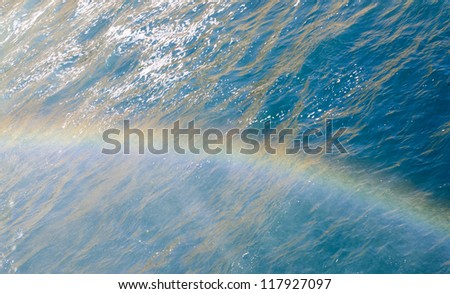 Rainbow above the surface of Mediterranean sea in the spray of a waterfall Lower Duden -?? Antalya, Turkey