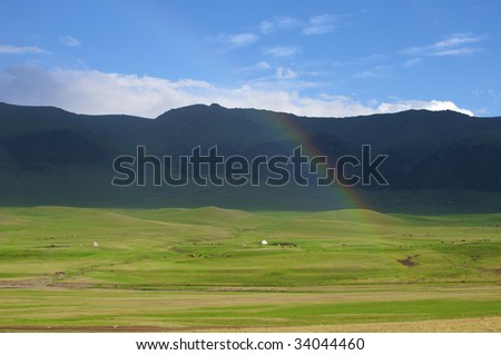 Rainbow after the storm in the mountains of Almaty region national park Assy