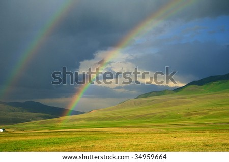Rainbow after the storm in the mountains of Almaty region national park Assy - stock photo