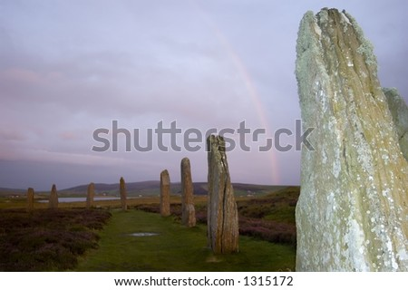 Rainbow arch in background at Ring of Brodgar, stone circle at Orkney, Scotland