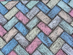 Rainbow art. Vibrant rainbow chalk art. block paving coloured in multicoloured chalk. Kids art projects.