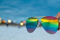 rainbow beach sunglasses reflecting beach