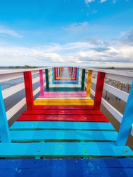 Rainbow Bridge and seaside bridge, bright colors, eye-catching contrast with the clear blue sky and a panoramic view of the sea