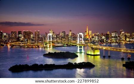 Rainbow Bridge and Sumida River in Tokyo, Japan. Night photo.