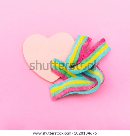 rainbow bubble gum with the heart. metaphor. non-traditional orientation symbol. creative concept . minimal. symbolism #1028134675