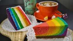 Rainbow Cake Slice with a cup of espresso coffee in a cafe - Casual Dining