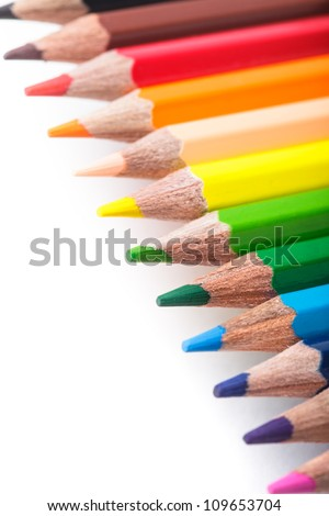 Rainbow color pencils in a row isolated on white