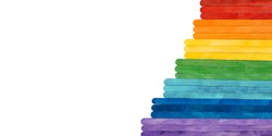 Rainbow color wooden ice cream sticks on white. Colorful abstract stairs