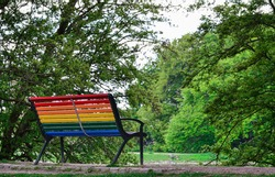 Rainbow colored bench in a park. Because of Covid-19 the Pride-parade can not be hold and the city of Malmö shows the support for the LGBTQ-community on this way