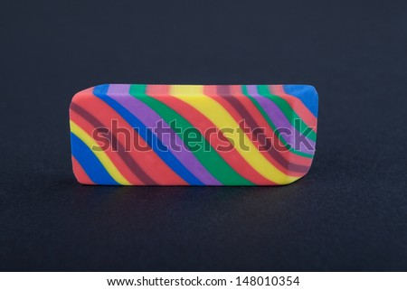 Rainbow colored eraser on the black background