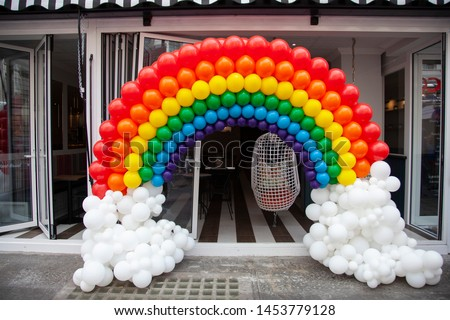 Rainbow enterance made from coloured balloons #1453779128
