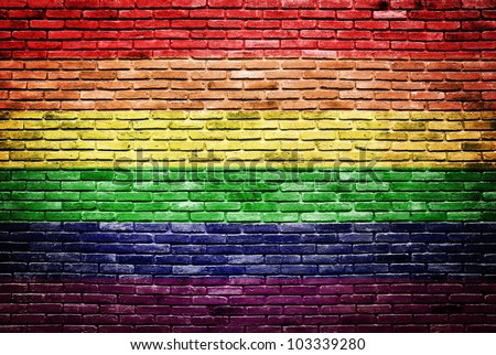 Rainbow flag painted on old brick wall texture background